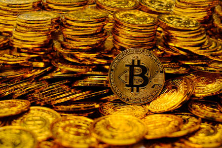 Bitcoin cryptocurrency on pile gold coins a lot of