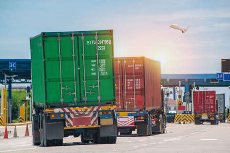 Container delivery by truck to gate in to container yard for export, logistic import export and transport industry background