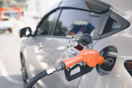 Pumping gasoline fuel in car at gas station, Fuel Station ,transportation self service energy concept.