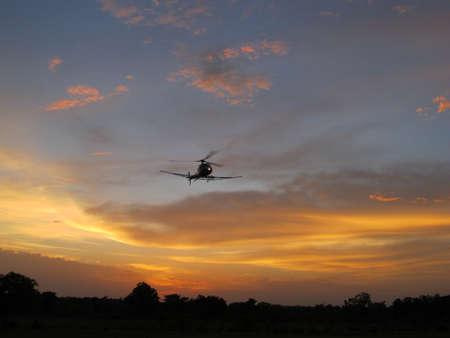 Elicottero con tramonto in Burkina Faso