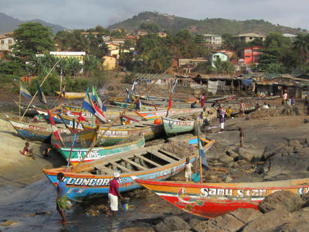 sierra leone: Colourful fishing boats in Sierra Leone Editorial