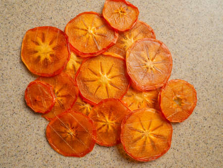 A lot of dried orange persimmon flatlay