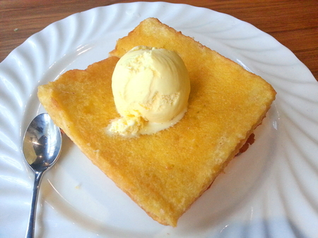 topped: French Toast Topped with Ice Cream Stock Photo