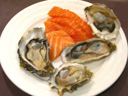 Raw Norwegian Salmon Pieces & Raw Pacific Rock Oysters photo