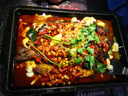 fish fire: Roast Fish in Iron Plate on Charcoal Fire