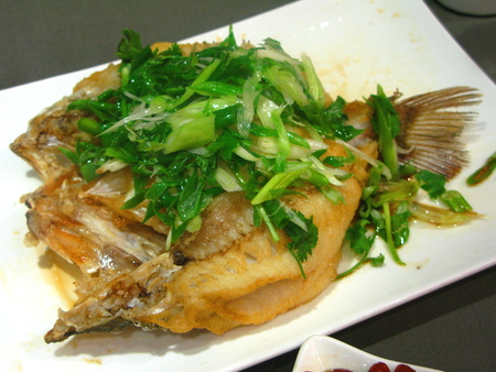 perch: Fried Perch Topped with Spring Onion Stock Photo