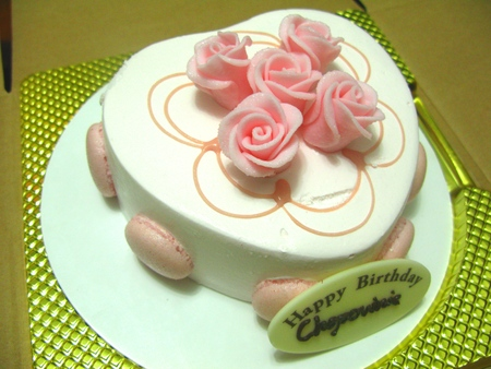 Heart Shaped Birthday Cake Topped with Rose Decoration