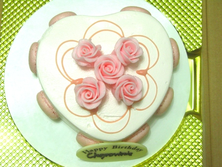 roses and blood: Heart Shaped Cake Decorated with Rose Stock Photo