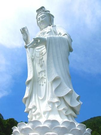 Tall White Bodhisattva (Guan Yin) Under Blue Sky