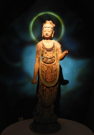 Standing Buddha and Corona Stock Photo