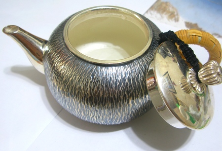 expensive: Inside A Silver Teapot Stock Photo