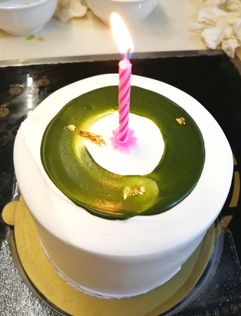 Gold Foil Matcha Birthday Cake with Candlelight