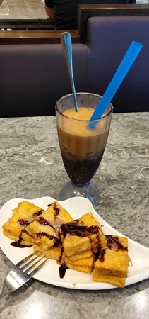 Mini French toasts served with red bean ice milk tea