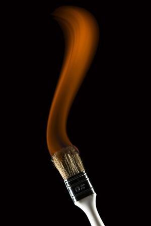 Burning paintbrush on black background painting with fire Stock Photo - 17485550