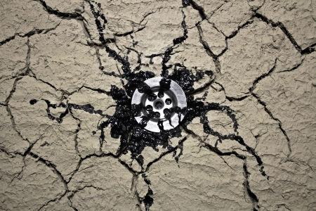 Oil leaking throuth water drain in dry soil Stock Photo - 17485845