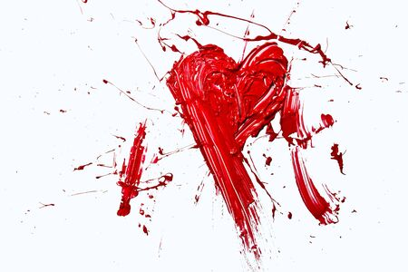 Bursting red color painted love heart photo