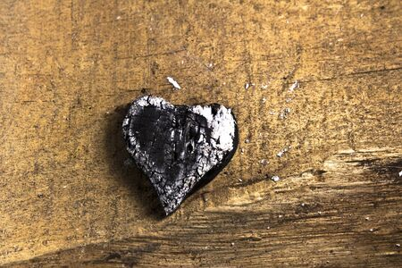 Burned wooden love heart on wooden background Stock Photo - 17485847