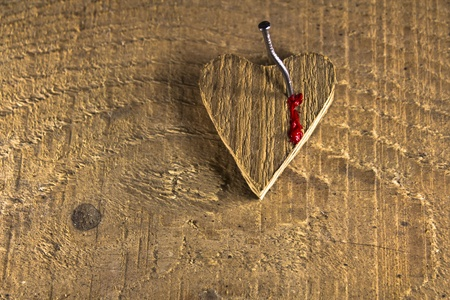 Love heart nailed on wooden background and bleednig Stock Photo - 17485843