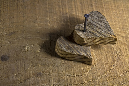 Two wooden love heart nailed on wooden background Stock Photo - 17485840