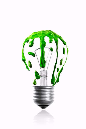 Green color dripping in shape of  light bulb photo