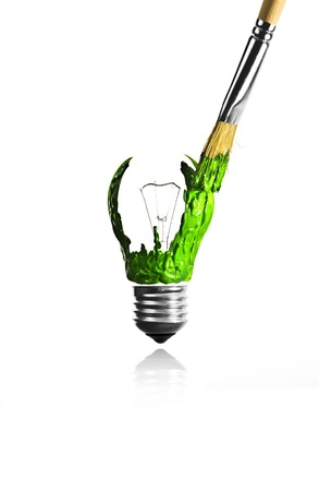 Paintbrush paint a green light bulb shape photo