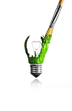 Paintbrush paint a green light bulb shape Stock Photo - 17485554