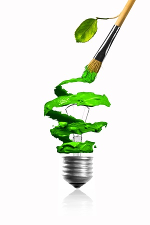 Paintbrush with growing leaf making a lightbulb color trace Stock Photo - 17485805