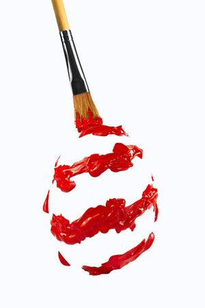 Red paint shaped spiral egg form by the brush Stock Photo