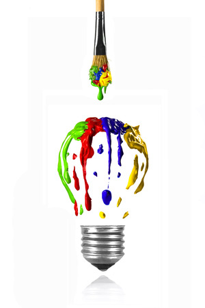 Paint dripping from the paintbrush in form of light bulb Stock Photo