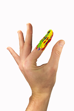 Hand with one multicolor painted finger Stock Photo