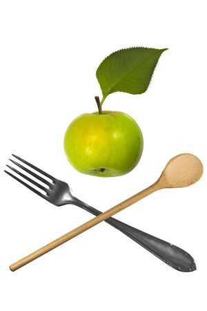 Green apple with fork and spoon Stock Photo