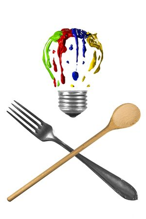Crossed fork and spoon with bulb above Stock Photo