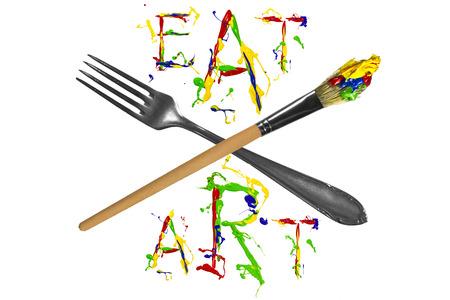 eslogan: Tenedor, pincel y lema colorido entre Foto de archivo