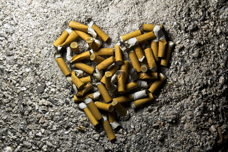 Love heart made of smoked cigarettes Stock Photo