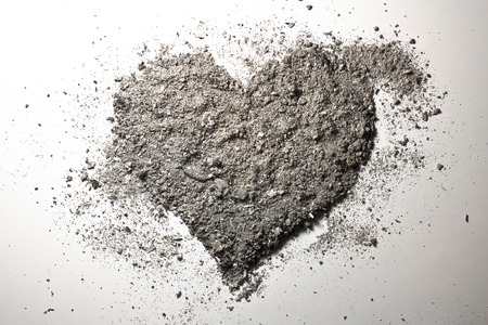 Grey love heart made of ash Stock Photo