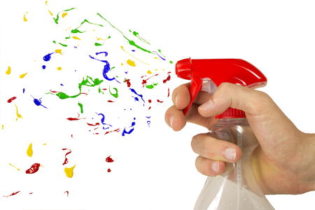 playfull: Multicolor paint bursting out of spray Stock Photo