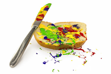 Multicolor paint spread on the bread Stock Photo