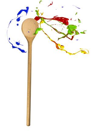 orbiting: Multicolor paint splash orbiting around the ladle