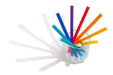 deutschemarks: The coloredl pencils in a glass on the white background Stock Photo