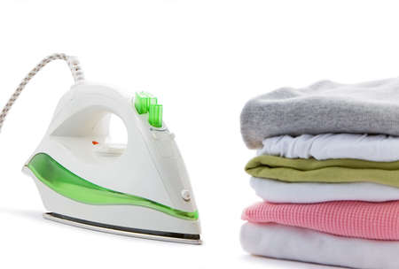 electric iron and clothes on a white background photo