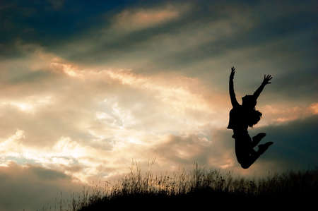 a jumping girl on the sunset background  photo