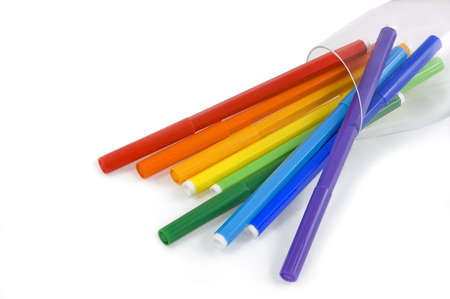 The coloredl pencils in a glass on the white background photo