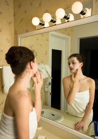 A beauty girl doing a cosmetik mask photo