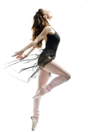 ballett: eine junge wunderbare Ballerina tanzt anmutig