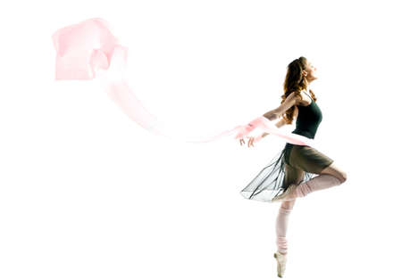 wonderful: a young wonderful ballerina is dancing gracefully
