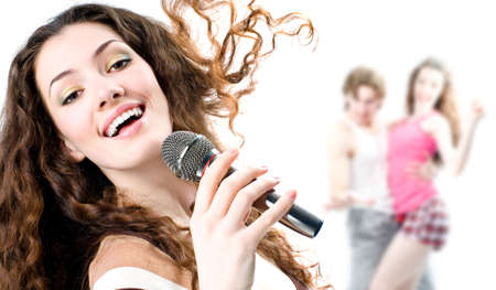 karaoke singer: pretty girl singing at the revelry party