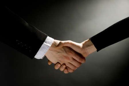 businesmen making partner handshake