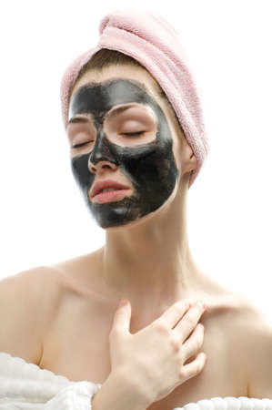 a beauty young girl making a cosmetic mask photo