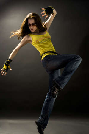 a young nice girl dancing modern dances Stock Photo