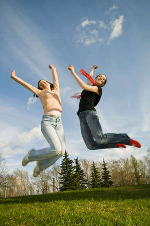 happy girls jumping in the open air Stock Photo - 3071142